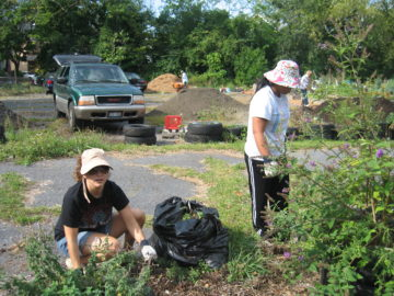 EC Community Grows Community Garden Event, 2010: FreshLink team members Kelly Melvin-Campbell and Melinda Laroco Boehm smile for the camera.