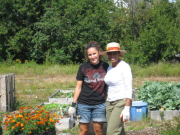 EC Community Grows Community Garden Event, 2010: Kelly Melvin-Campbell and Tanisha Tate take a break from pulling weeds to get a picture.