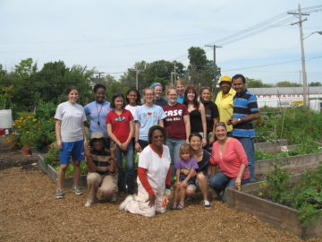 EC Community Grows Community Garden Event, 2010: Gardeners, FreshLink staff, PRCHN volunteers, and CWRU volunteers pause for a picture.