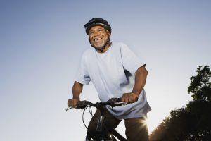 Smiling senior man with mountain bike